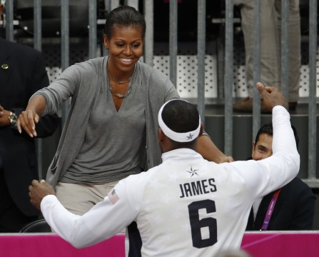 U.S. first lady Michelle Obama hugs U.S. basketball player LeBron James at the end of a men's preliminary round basketball match in London, Michelle Obama